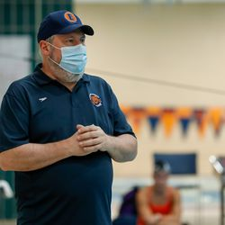 Evanston coach Kevin Auger gives instruction during swim practice on August 19, 2020.