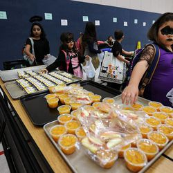 Students choose food during the Breakfast in the Classroom program at Backman Elementary School in Salt Lake City on Friday, Oct. 28, 2016. At right is student Candice.