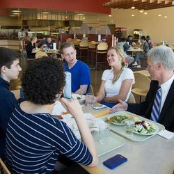 Students laugh and talk with new BYU President Kevin J Worthen during an impromptu lunch on campus on Thursday, May 1, 2014, his first day on the job.