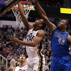 Alec Burks of the Utah Jazz takes a shot while defended by Elton Brand of the Dallas Mavericks during NBA basketball in Salt Lake City, Monday, Jan. 7, 2013. At lower left is Enes Kanter of the Utah Jazz.