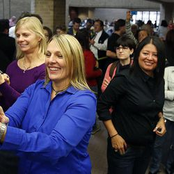 Friends take photos as couples emerge from the Salt Lake County clerk's office with marriage licenses, Monday, Dec. 23, 2013. At front is Tracey Gines. U.S. District Judge Robert Shelby denied a motion by the state of Utah to halt same-sex marriages pending an appeal.