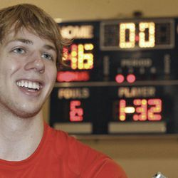 Caltech basketball player Ryan Elmquist poses with his team's winning scoreboard, background, in Pasadena, Calif. on Wednesday, Feb. 23, 2011. Elmquist hit the go-ahead free throw with 3 seconds left against Occidental College for the Division III Beavers, who had lost every Southern California Intercollegiate Athletic Conference game they had played since Jan. 23, 1985.