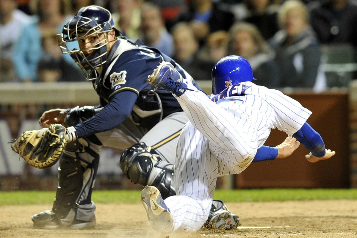 Darwin Barney  of the Chicago Cubs scores the winning run as Wil Nieves of the Milwaukee Brewers makes the tag on June 13, 2011 at Wrigley Field in Chicago, Illinois. The Cubs defeated the Brewers 1-0. (Photo by David Banks/Getty Images)