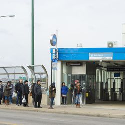 People wait outside of the Addison Blue Line station in Avondale.    Tyler LaRiviere/Sun-Times