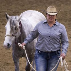 Breanne Cowan leads her horse, Merle Haggard's Flaming Glow, to wait for the final consensus during the Wild Horse and Burro Show at the Legacy Events Center in Farmington on Friday, June 9, 2017. Cowan decided on her horse's name hours before the show, finding inspiration from a new Cracker Barrel drink and a CD in her car.
