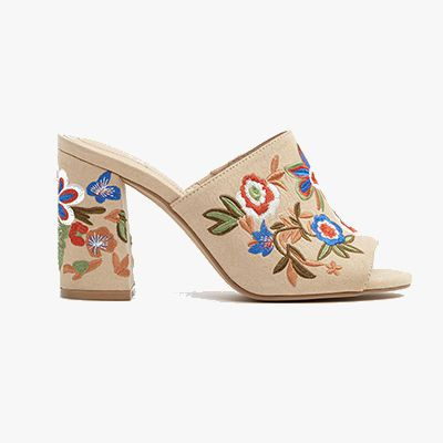 Ivory embroidered mules.