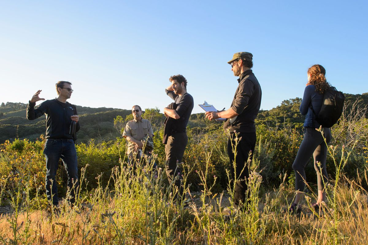 Developer Nick Jekogian (left) takes team on a tour of Monterey Walden land.