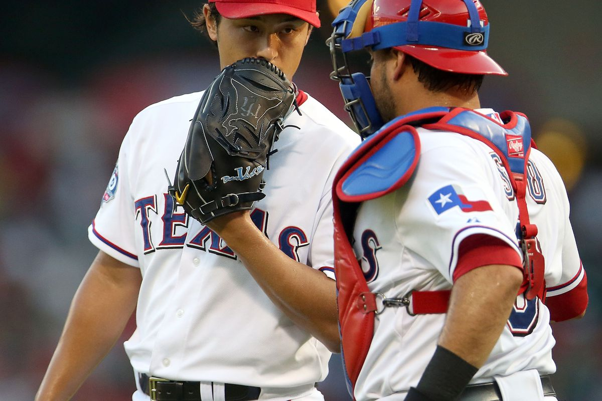 ARLINGTON, TX - AUGUST 28:  Yu Darvish #11 of the Texas Rangers with Geovany Soto #8 during play against the Tampa Bay Rays at Rangers Ballpark in Arlington on August 28, 2012 in Arlington, Texas.  (Photo by Ronald Martinez/Getty Images)