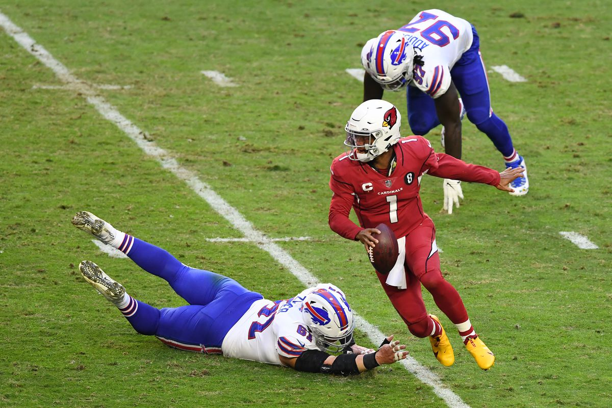 Quarterback Kyler Murray #1 of the Arizona Cardinals runs the ball as defensive tackle Justin Zimmer #61 and defensive end Mario Addison #97 of the Buffalo Bills defend during the first half at State Farm Stadium on November 15, 2020 in Glendale, Arizona.