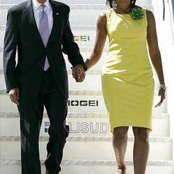 President Barack Obama, left, and his first lady Michelle Obama, right, arriving in Pratica di Mare military airport on the outskirts of Rome.