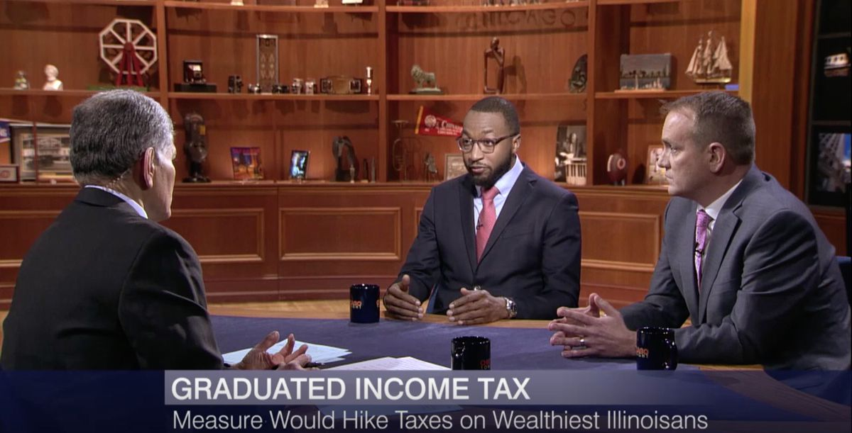 "Quentin Fulks, center, of Vote Yes For Fairness, discusses the proposed graduated income tax on WTTW-TV's ""Chicago Tonight."""