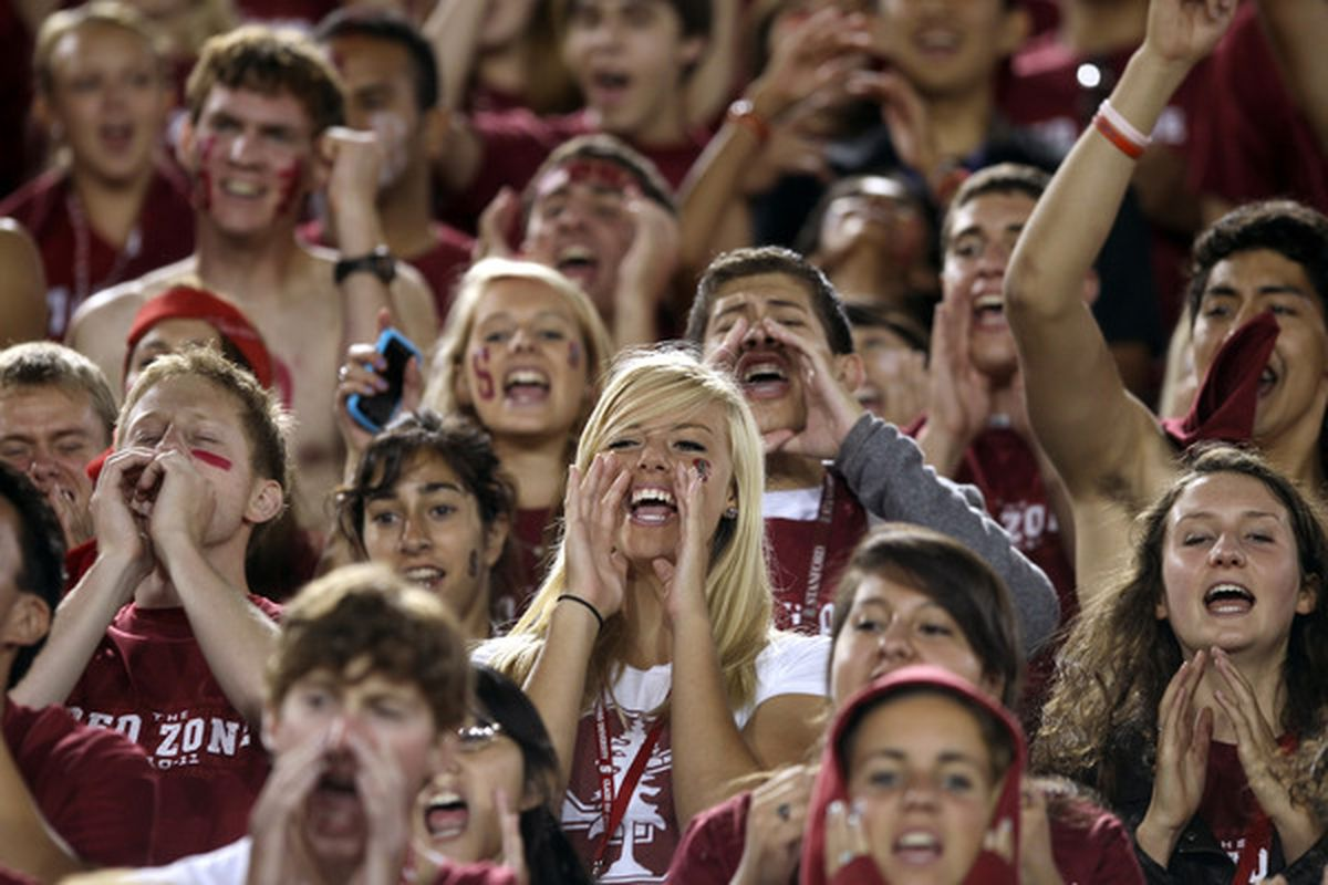 PALO ALTO CA - SEPTEMBER 18:  Stanford Cardinal fans cheer for their team as they warm up before their game against the Wake Forest Demon Deacons at Stanford Stadium on September 18 2010 in Palo Alto California.  (Photo by Ezra Shaw/Getty Images)