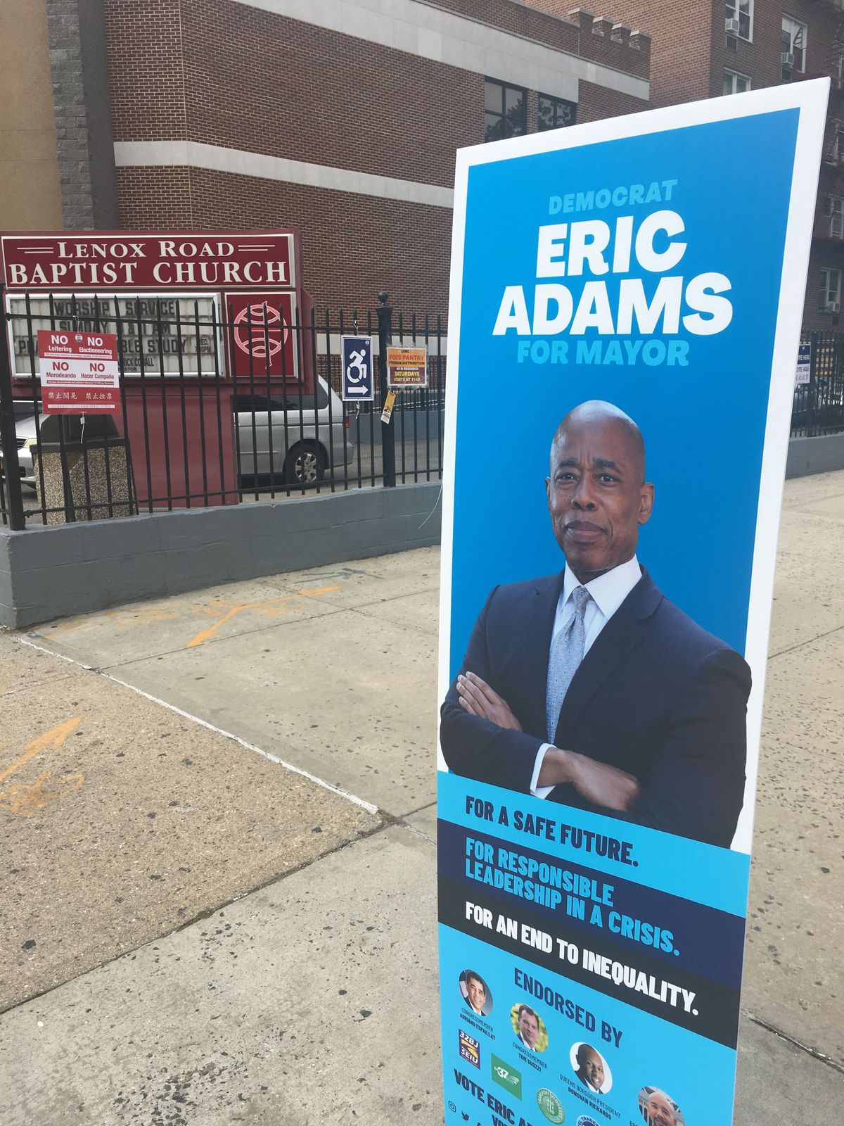 Eric Adams led the crowded field of Democratic mayoral hopefuls as of Tuesday night. A sign for the candidate on the street in front of a Brooklyn polling site.