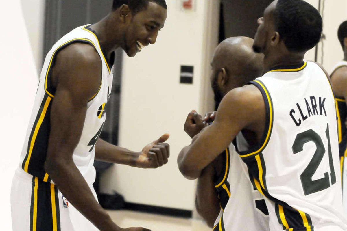 The Jazz's Jeremy Evans, left, goofs around with teammates Scott Machado, center, and Ian Clark in between photos during media day at the Zions Bank Basketball Center on Monday, September 30, 2013.