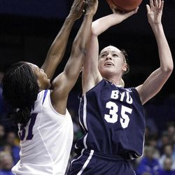 BYU forward Kristen Riley (35) shoots over DePaul forward Jasmine Penny during the first half of an NCAA tournament first-round game in Rosemont, Ill., on Saturday.