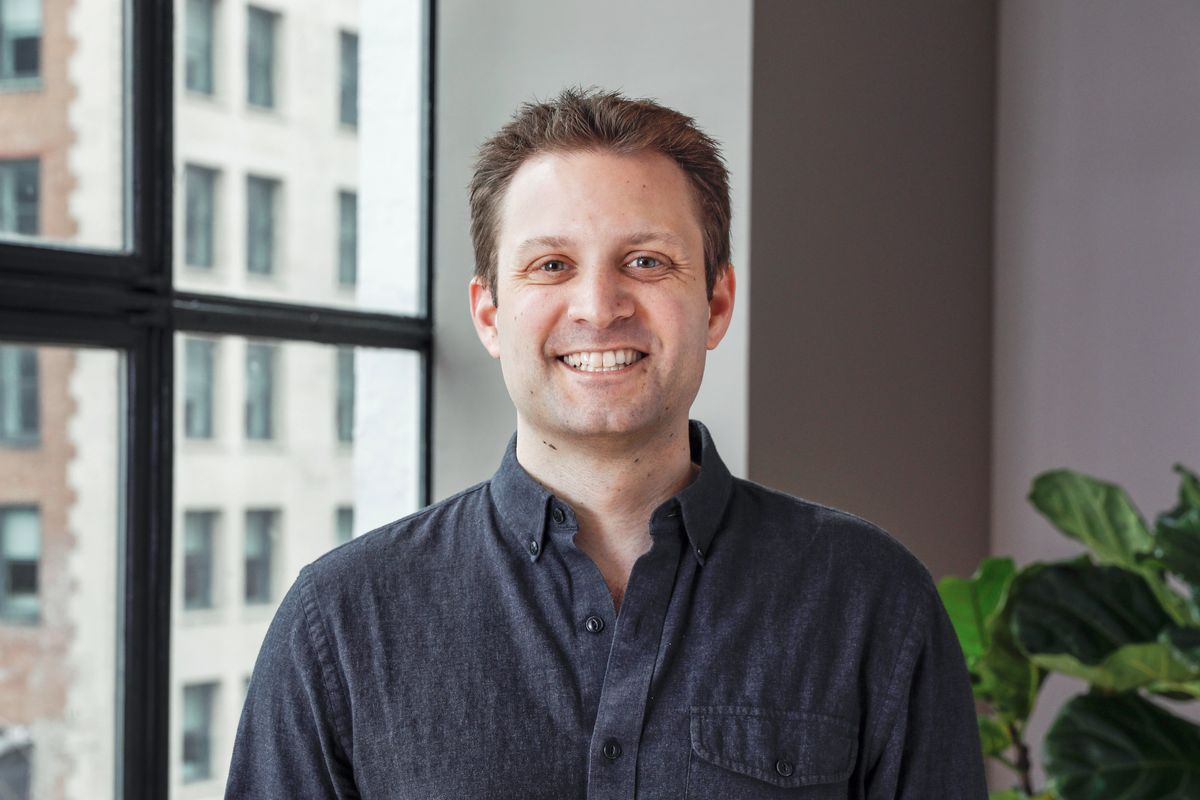 Blue Apron co-founder and CEO Matt Salzberg is shown standing in front of a window.