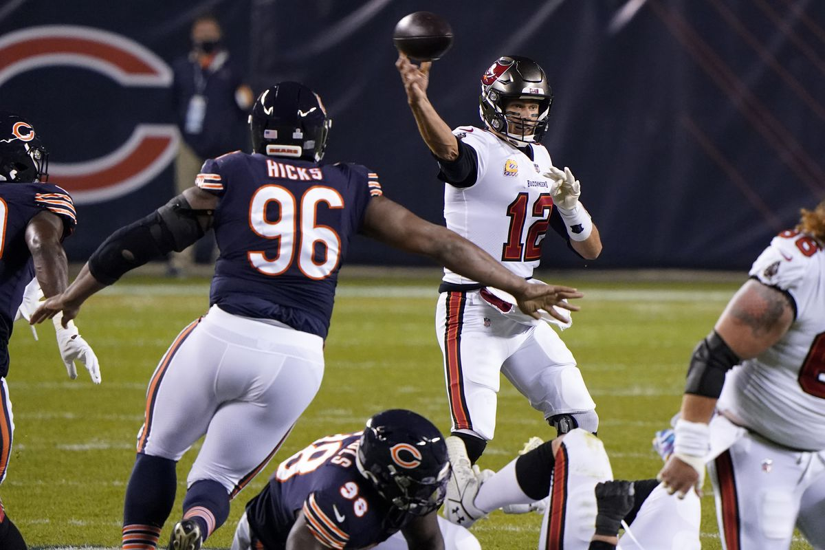Buccaneers quarterback Tom Brady (12) drops back to pass against the Chicago Bears during the first quarter at Soldier Field.
