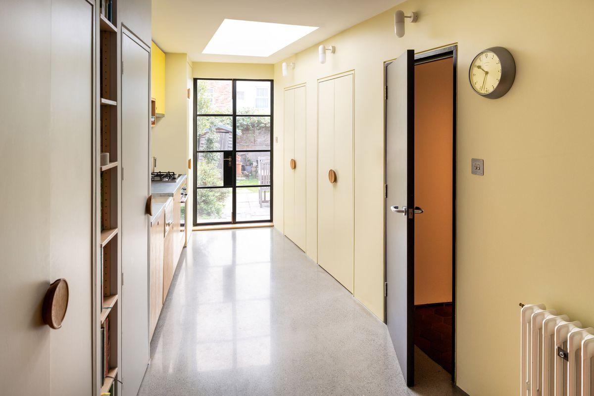Hallway with concrete flooring