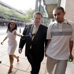 Kenneth W. Smith Jr., right, accompanied by his lawyer Bill Brennan walks near the U.S. Courthouse, Friday, Sept. 7, 2012, in Philadelphia. Smith was arrested and is charged with making a hoax threat that led authorities to recall a plane in midair to the Philadelphia airport. Federal authorities charged 26-year-old Smith Jr. with conveying false and misleading information. According to a criminal complaint, Smith called police at the airport on Thursday, Sept. 6, 2012 and falsely reported a passenger was carrying an explosive substance. Authorities then recalled a Dallas-bound US Airways flight to Philadelphia.