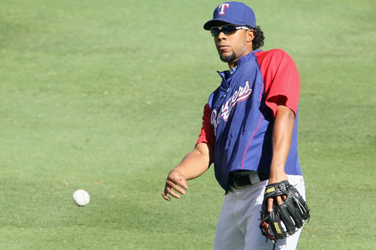ARLINGTON TX - OCTOBER 14:  Elvis Andrus #1 of the Texas Rangers throws the ball during their workout session on October 14 2010  at the Rangers Ballpark in Arlington in Arlington Texas.  (Photo by Elsa/Getty Images)