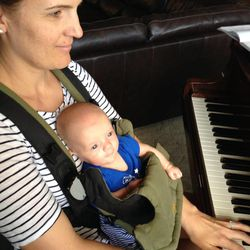 Christian enjoys playing the piano with his mom.