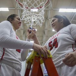East's Liana Kaitu'u and Lani Taliauli cut the basketball net following East's 68-48 victory against Timpview in the Class 5A state championship game at Salt Lake Community College in Taylorsville on Saturday, Feb. 24, 2018.