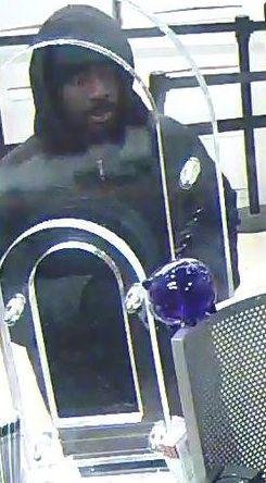 Surveillance photo of the suspect who robbed a Near West Side bank Tuesday evening. | FBI