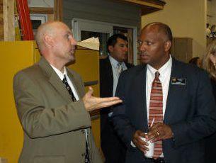 Randy Johnson talks to former Colorado Education Commissioner Dwight Jones. <em>EdNews</em> file photo