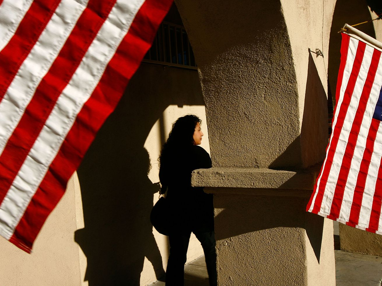 Voters go to the polls for primary elections in the predominantly Latino neighborhood of Boyle Heights on February 5, 2008, in Los Angeles, California.