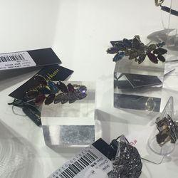 Rings and earrings, $65
