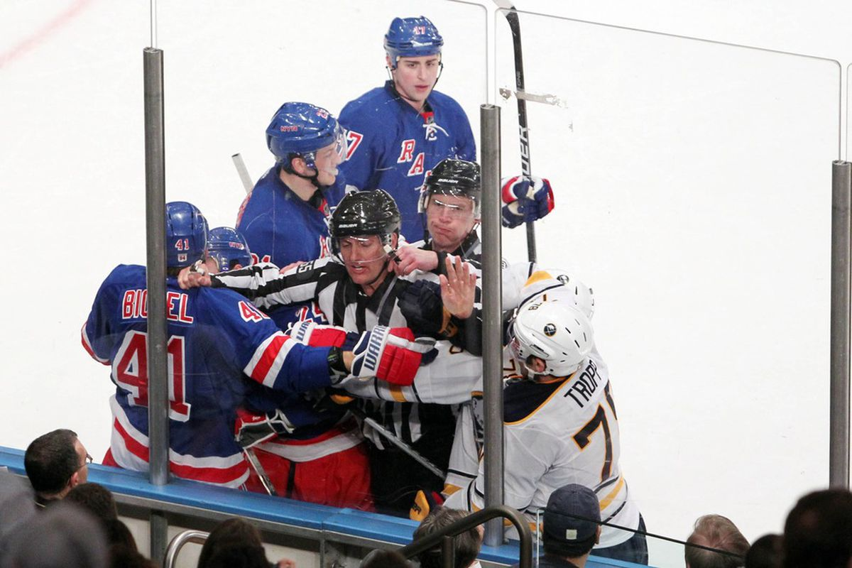 Mar 23 2012; New York, NY, USA;  Referees stop a fight between the New York Rangers and the Buffalo Sabres during the second period at Madison Square Garden.  Mandatory Credit: Anthony Gruppuso-US PRESSWIRE
