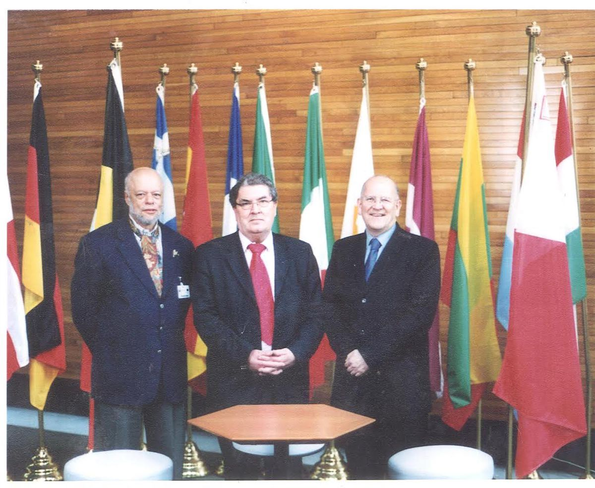 Buzz Palmer (left) with Nobel Prize-winner John Hume, a Northern Irish political peacemaker, and Glyn Ford, a former member of the European Parliament. Mr. Palmer often wore a cravat at formal occasions.