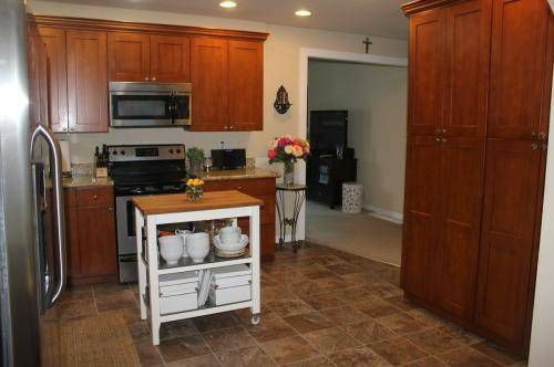 A kitchen with wood cabinets and an island