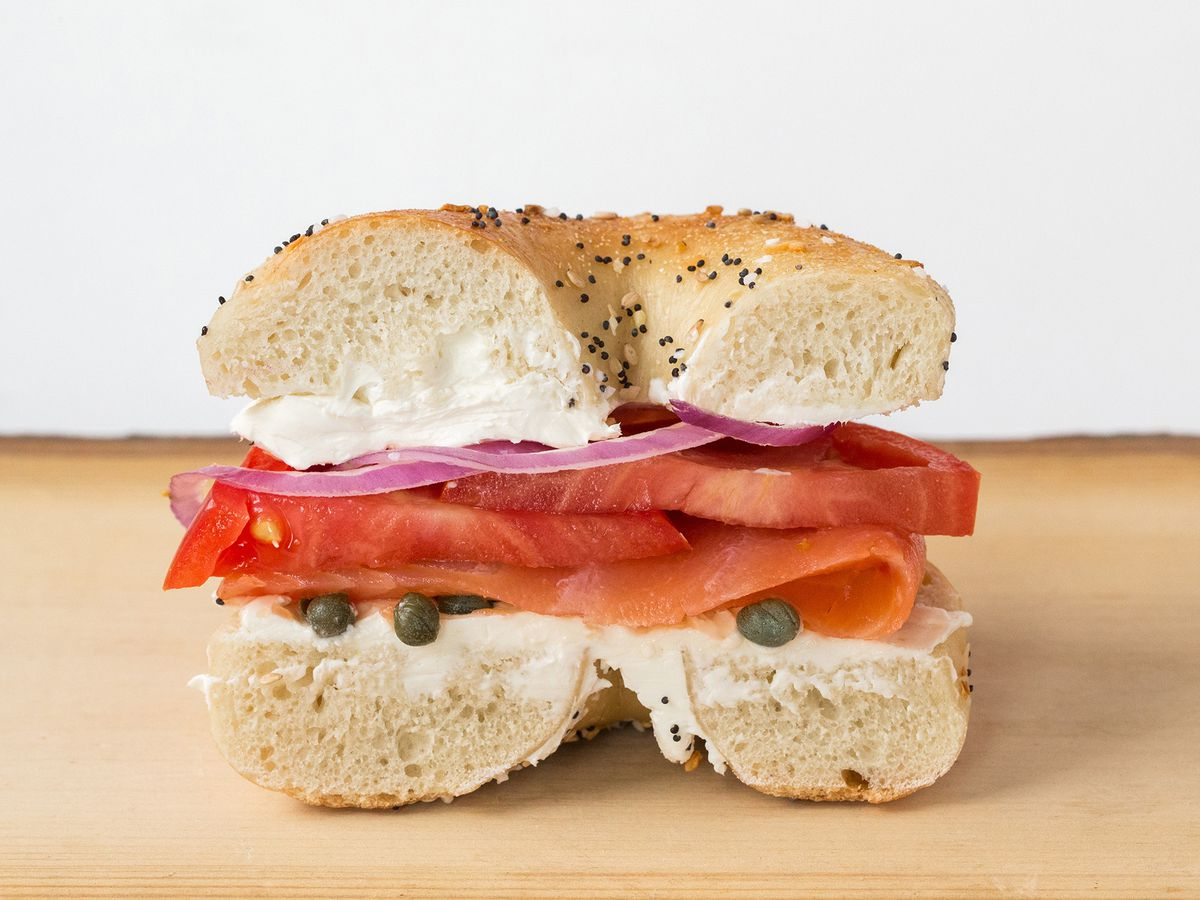 half a bagel sandwich with lox and tomato