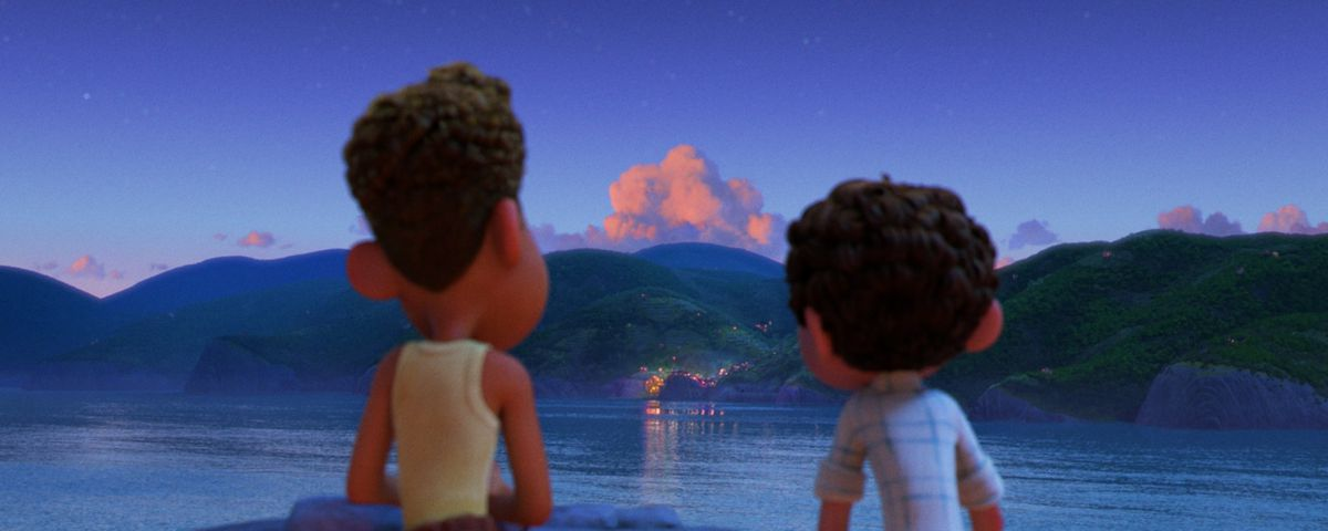 luca and alberto looking out at a town in the evening