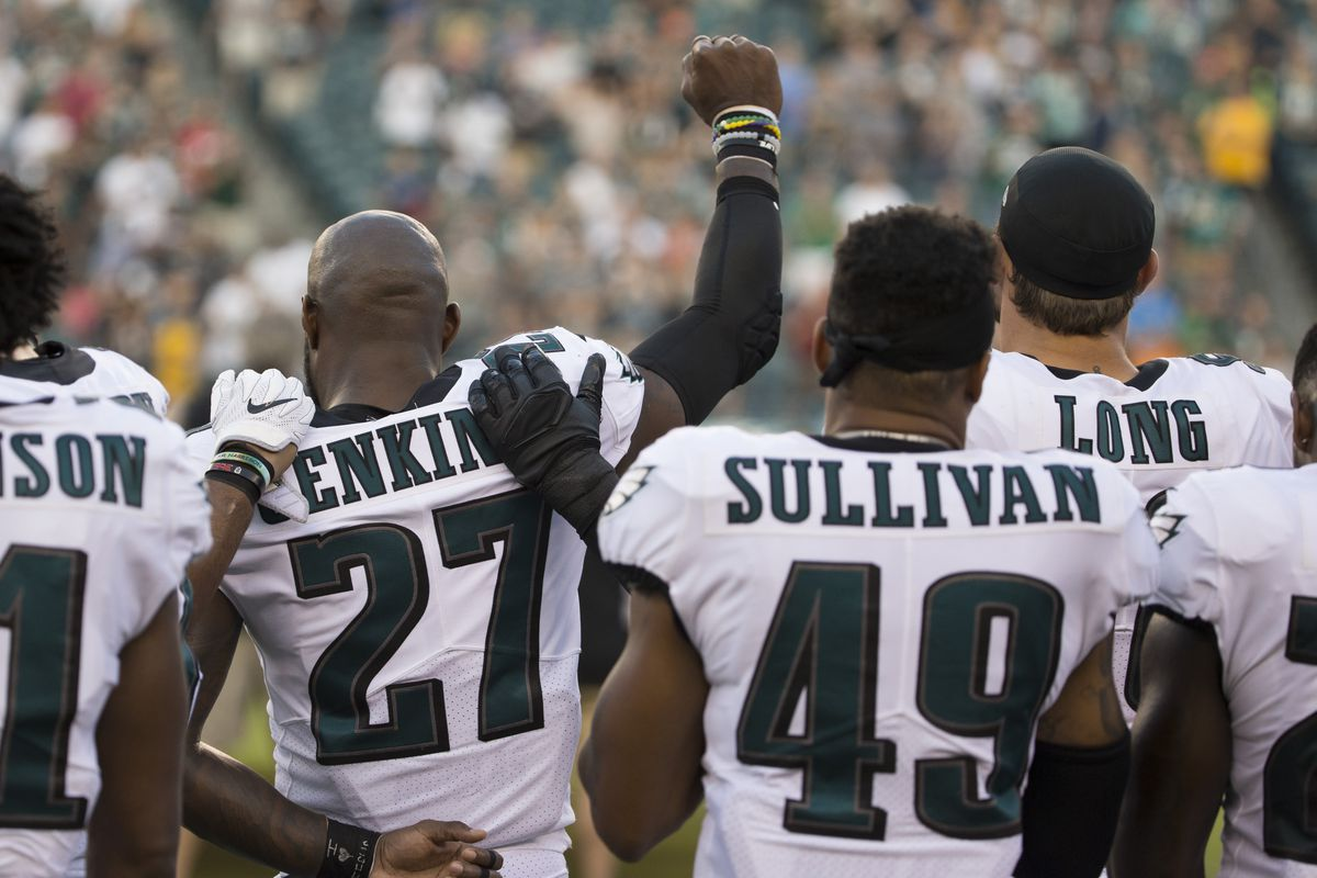 Philadelphia Eagle Malcolm Jenkins holds his fist in the air during the national anthem