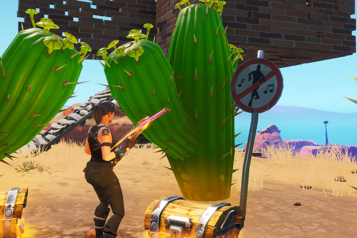 A Fortnite player standing in front of a no dancing sign