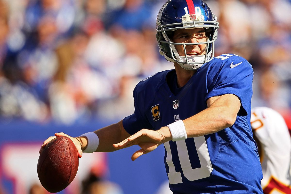 Eli Manning delivers a pass Sunday against the Washington Redskins.