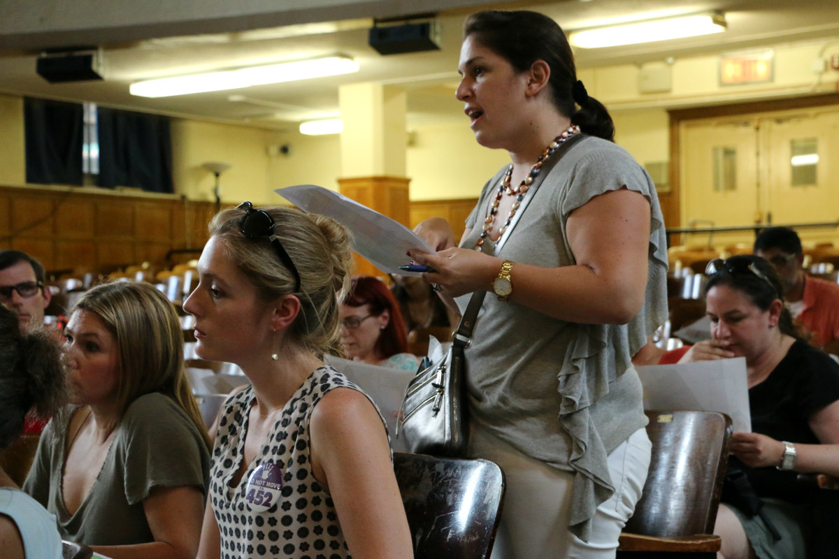 An attendee at Thursday's meeting questioned an education department official about the plan.