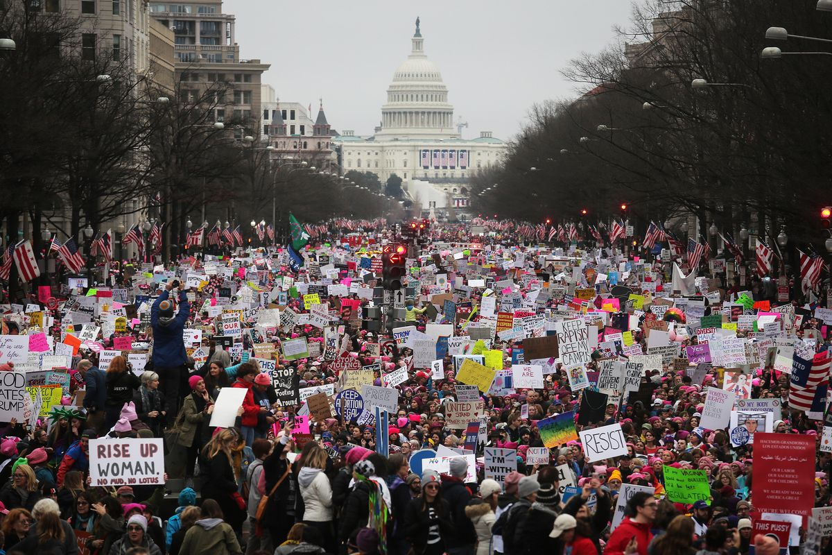 Protesters walk up Pennsylvania Avenue during the Women's March on Washington.