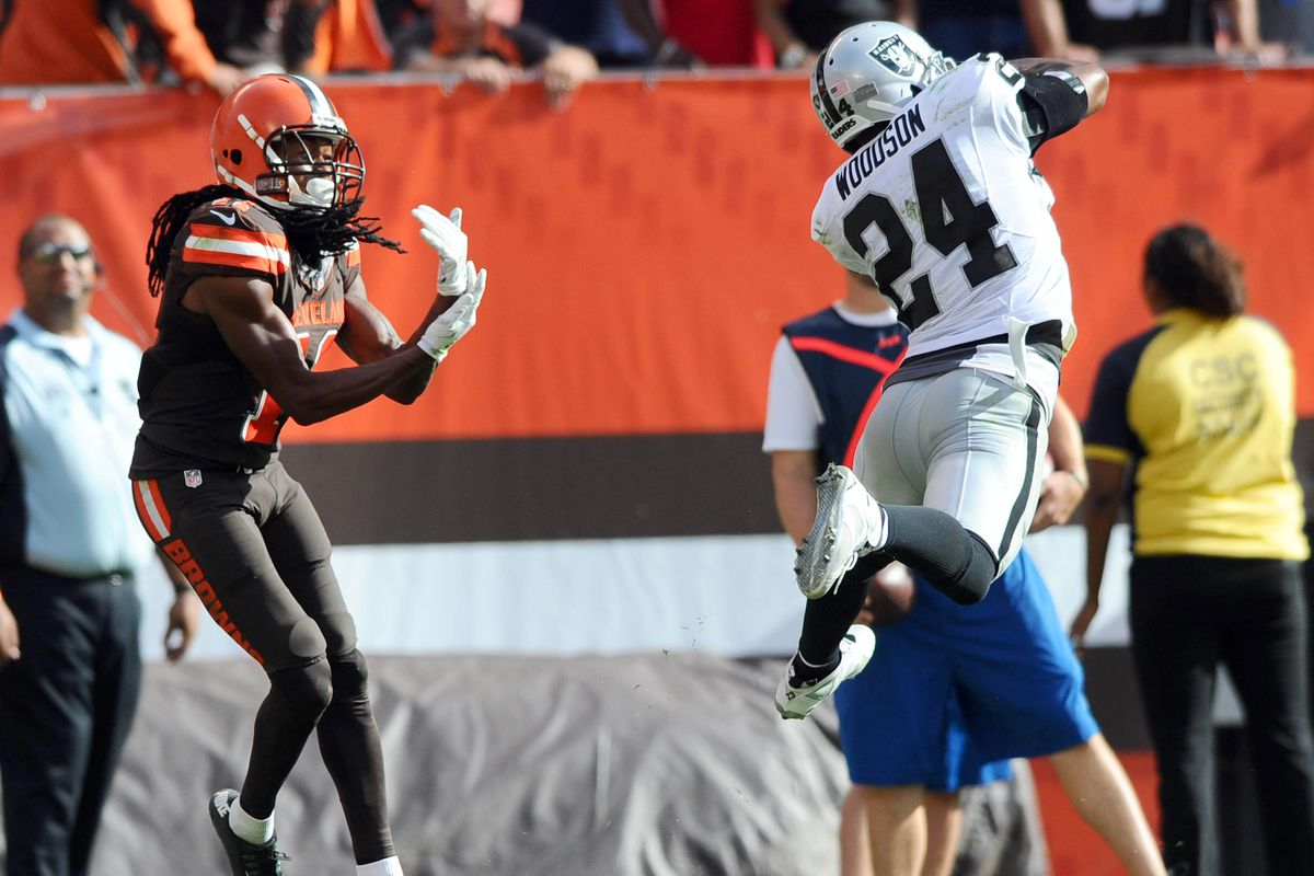 S Charles Woodson intercepts a Josh McCown pass to seal a Raiders victory.