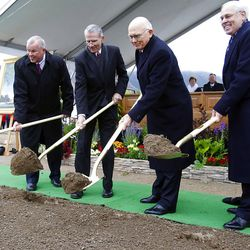 (Left to Right) Elder Steven E. Snow of the Seventy, Elder J E Jensen Presidency of the Seventy, Elder Dallin H. Oaks of the Quorum of the Twelve Apostles, and Elder William R. Walker of the Seventy turn over the first shovels of dirt as thousands turn out in the rain Saturday, Oct. 8, 2011 for the ground breaking for the Payson Temple.