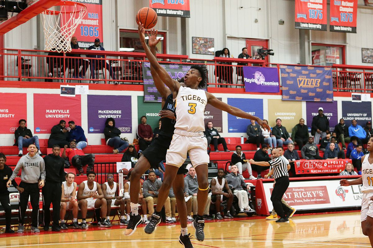 Joliet West's Jaiden Lee drives to the basket as the Tigers play Hillcrest.