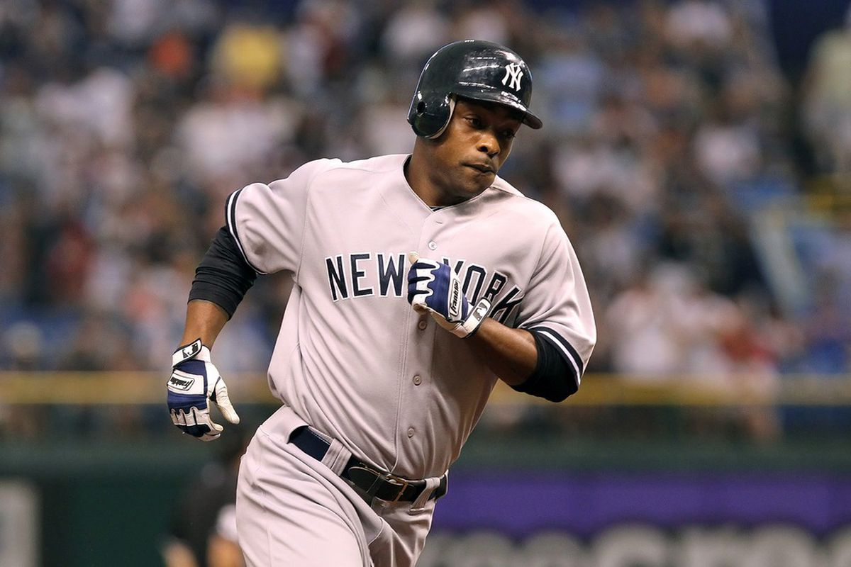 July 3, 2012; St. Petersburg, FL, USA; New York Yankees left fielder Dewayne Wise (45) runs the bases after he hit a solo home run in the third inning against the Tampa Bay Rays at Tropicana Field. Mandatory Credit: Kim Klement-US PRESSWIRE