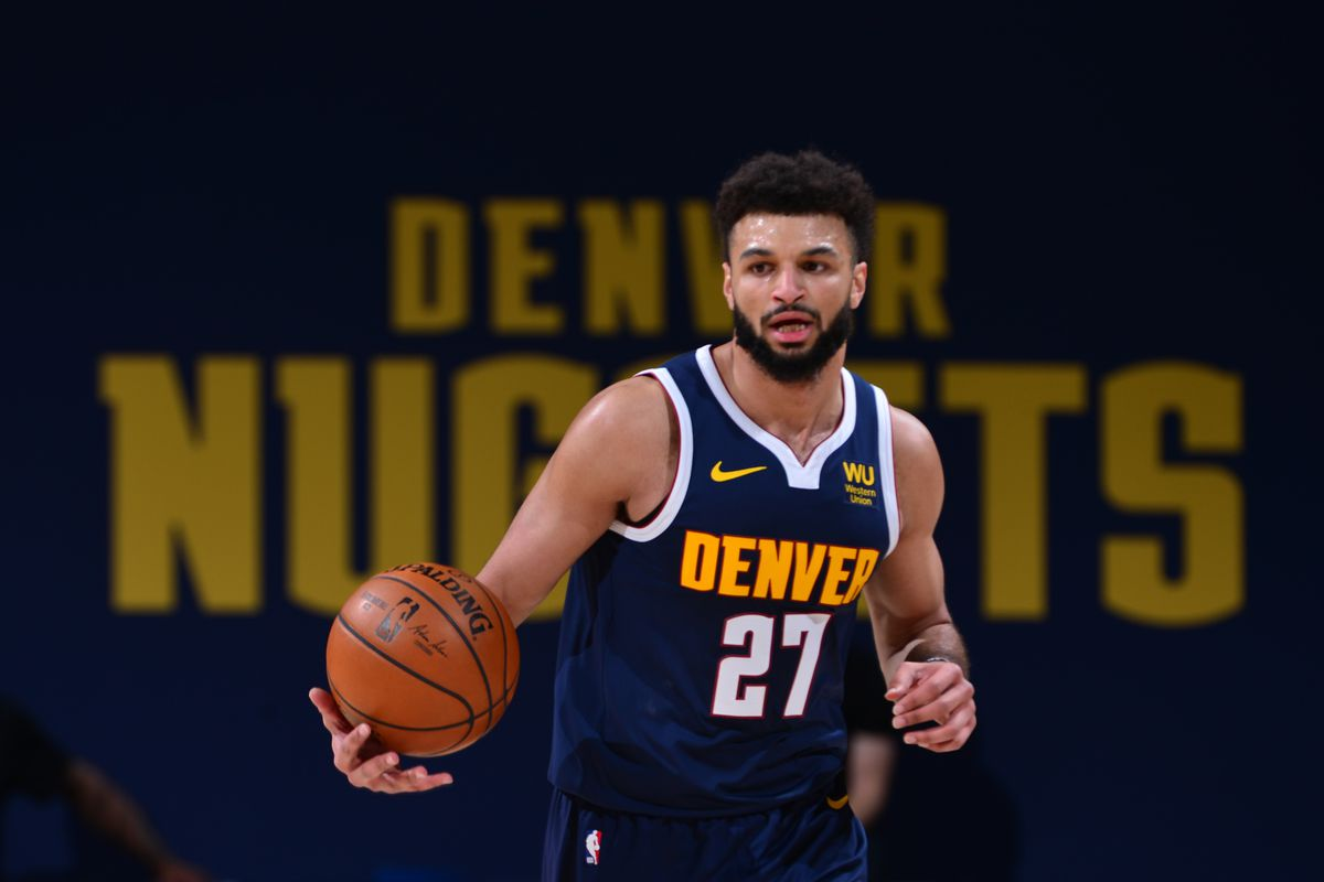 Jamal Murray of the Denver Nuggets handles the ball against the Utah Jazz on January 17, 2021 at the Ball Arena in Denver, Colorado.
