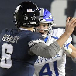 Utah State quarterback Andrew Peasley (6) looks to throw the ball as Air Force linebacker Matthew Malloy (41) defends during the first half of an NCAA college football game Thursday, Dec. 3, 2020, in Logan, Utah.