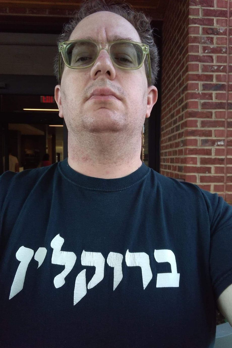 """Yonah Kohn, wearing a """"Brooklyn"""" shirt, says he was not given an adequate education in yeshivas he attended as a child."""