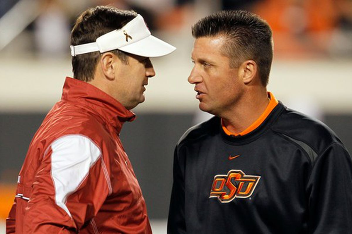 Oklahoma's Bob Stoops (left) and Mike Gunday of Oklahoma State
