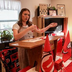 Ceciley Hallman Herod presents her brother with extra tassels in honor of his three bachelor's degrees during a mock commencement ceremony in their parents' Sugar House home amid the COVID-19 pandemic on Thursday, April 30, 2020. Joseph Hallman earned bachelor's degrees in Latin American studies, Spanish and international business with an emphasis in trade commerce in 2019 with hopes of walking during the spring 2020 commencement ceremony.