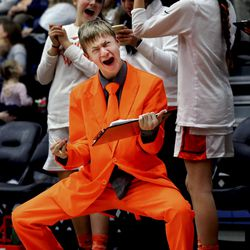 Skyridge High School team manager Caleb Klein celebrates with the bench as Skyridge takes a lead against Murray during the 5A volleyball state quarterfinal match at Salt Lake Community College in Taylorsville on Thursday, Feb. 21, 2019. Klein purchased the suit with his own money and wears it only during home games and tournaments.